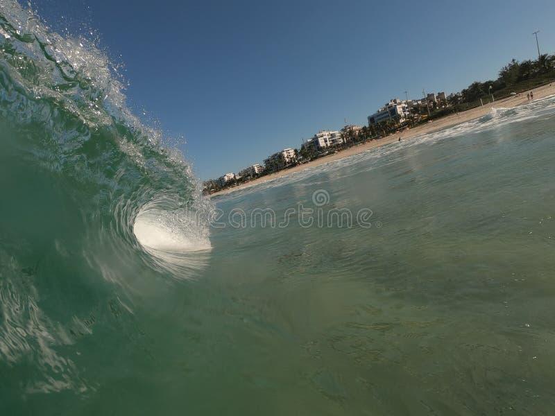 Wave breaking in the shore break royalty free stock photos