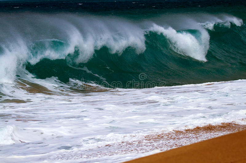 Wave Breaking On Shore. A wave breaking onshore on the coastline in Kauai, Hawaii royalty free stock photo