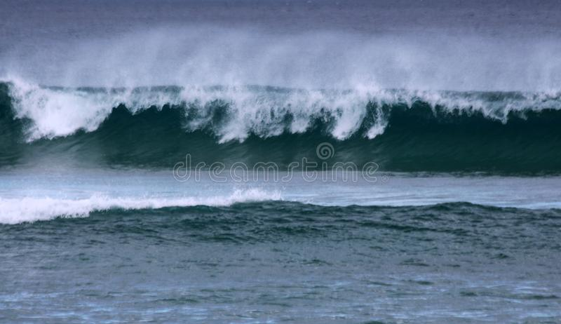 Wave Breaking on the Shore stock images