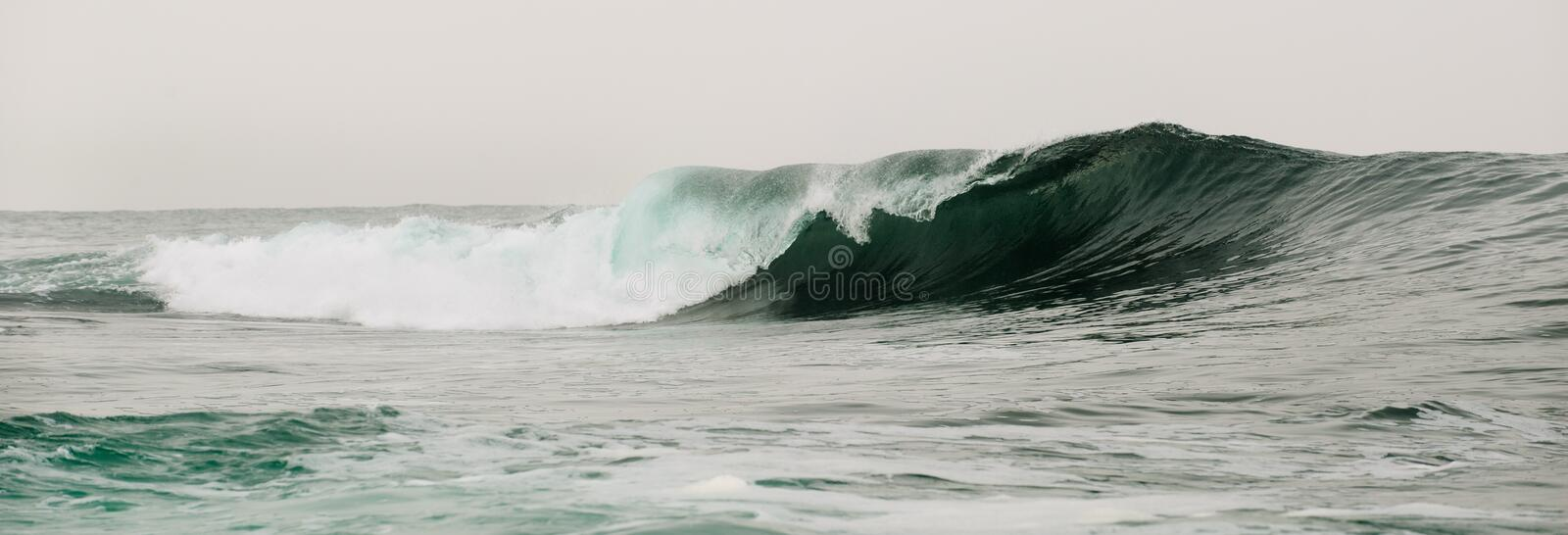 Wave breaks on a shallow bank. Wave on the surface of the ocean. Wave breaks on a shallow bank royalty free stock photos
