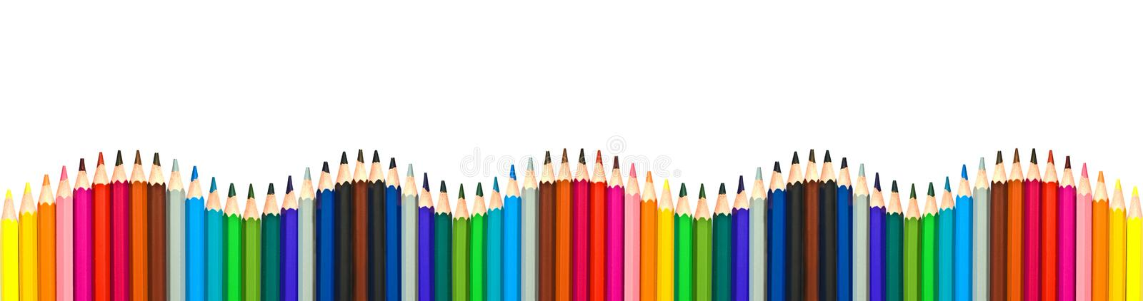 Wave of colorful wooden pencils isolated on white, panoramic background, back to school concept royalty free stock photos