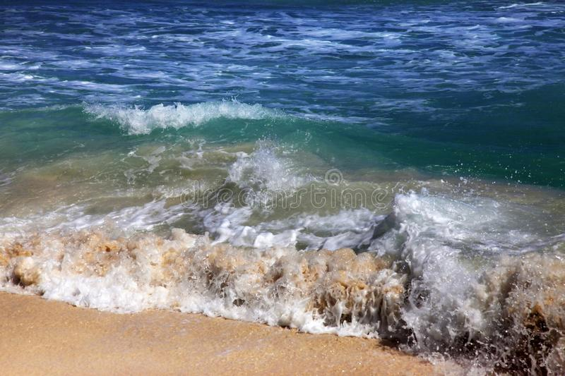 Wave crashes on to the shore. royalty free stock photo