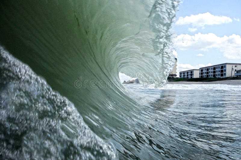 Wave Crashing. In Melbourne Beach Florida Condos in background royalty free stock images