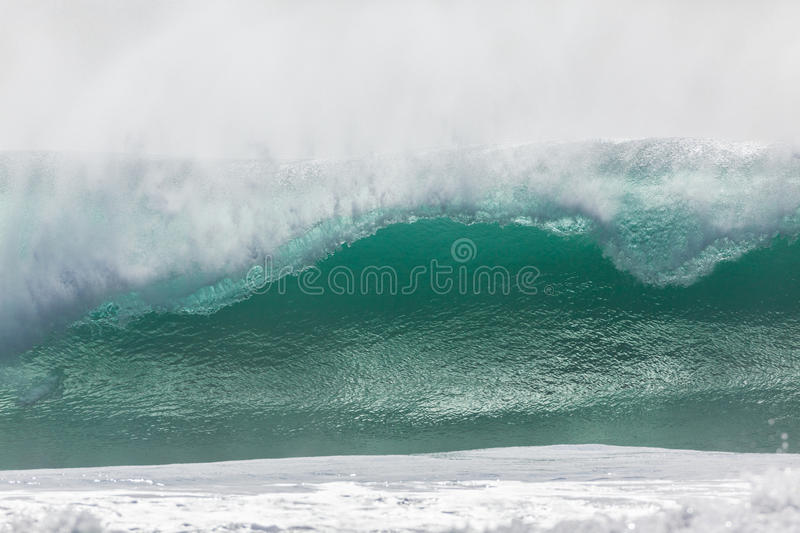 Wave Crashing. Ocean wave crashing water power from weather storms royalty free stock photography