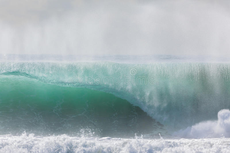 Wave Crashing. Ocean wave crashing water power from weather storms royalty free stock photos