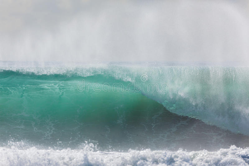 Wave Crashing. Ocean wave crashing water power from weather storms stock photo
