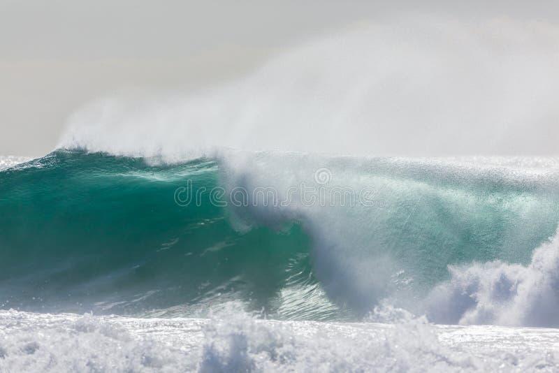 Wave Crashing. Ocean wave crashing water power from weather storms stock photos