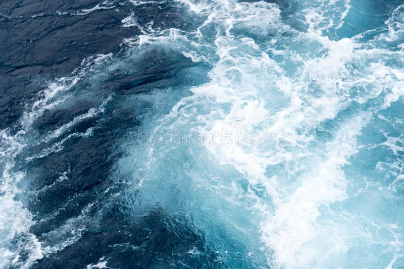 Wave created by ship sails pass through the sea water. Turbulance flow of sea water happen by the ship moving.  royalty free stock photo