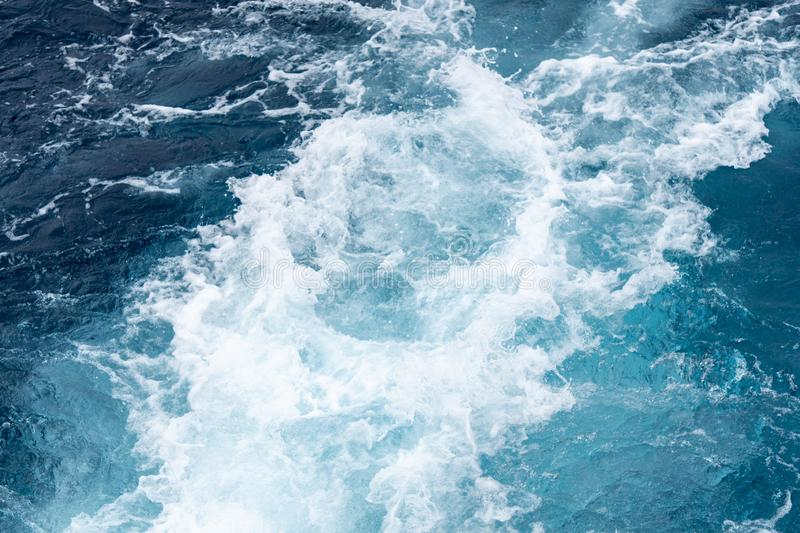 Wave created by ship sails pass through the sea water. Turbulance flow of sea water happen by the ship moving.  royalty free stock photos