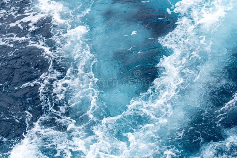 Wave created by ship sails pass through the sea water. Turbulance flow of sea water happen by the ship moving.  stock image