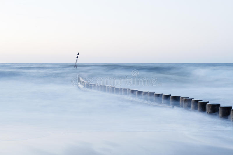 Wave flows around wooden breakwater