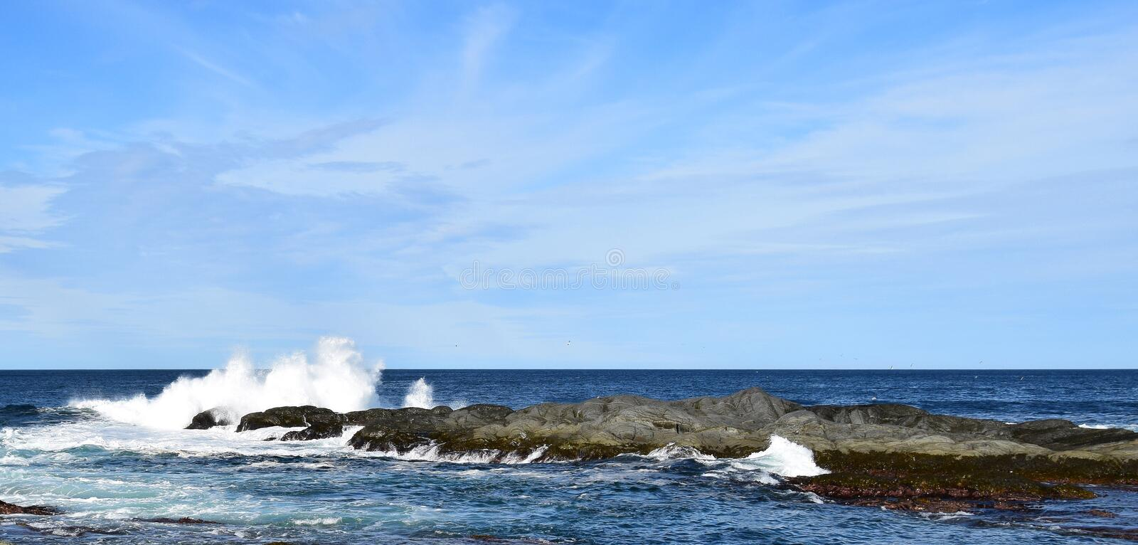 wave hitting a rock in the ocean making a big splash royalty free stock photography