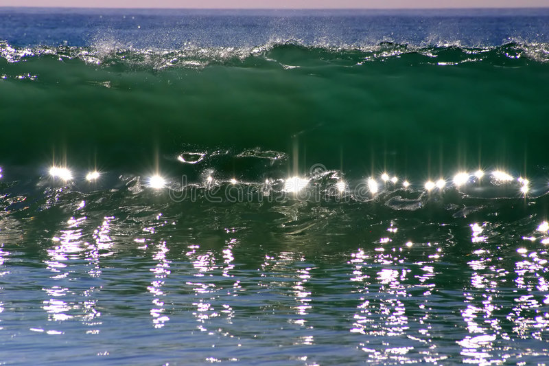 Wave Jewels. Reflections in a Crashing Wave look like Jewels stock photos