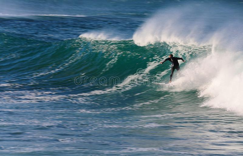 Wave joy ride. The waves at Die Punt near Mossel Bay on the Garden Route of South Africa offers lovely opportunities for surfing. The stormy weather on Sunday stock images