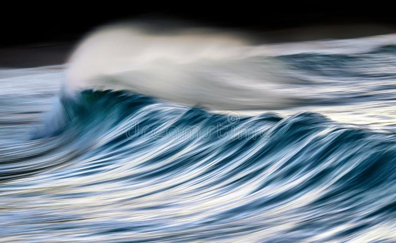 Wave in motion with panning effect. Smooth wave in motion with panning effect royalty free stock image