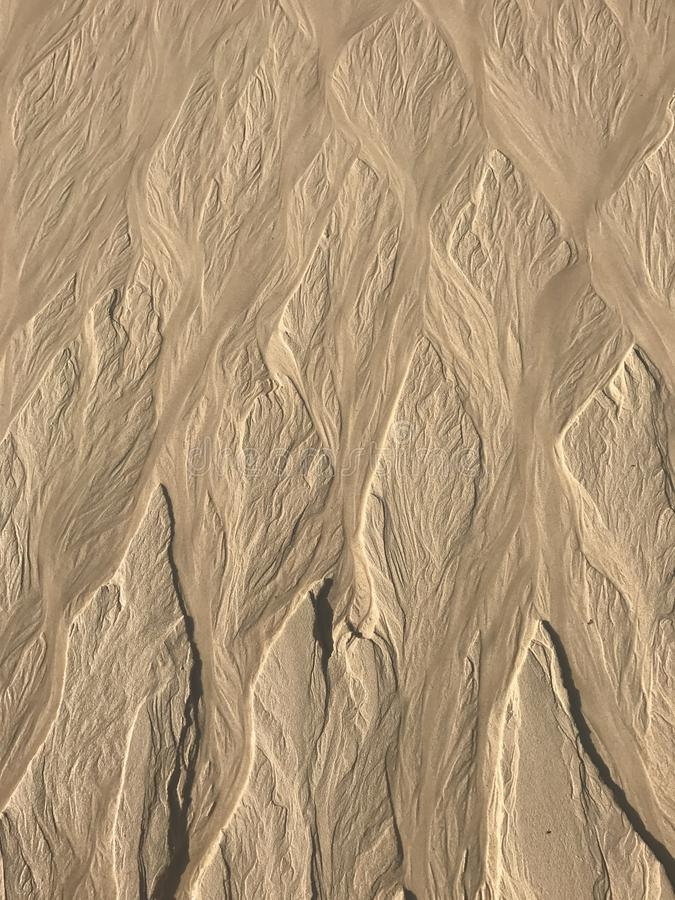 Wave patterns in the sand stock photos