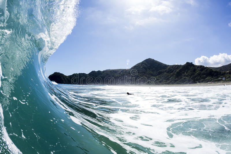 Wave Pitching, North Piha, New Zealand. A water shot taken as a perfect wave starts to pitch at North Piha Beach, New Zealand stock image