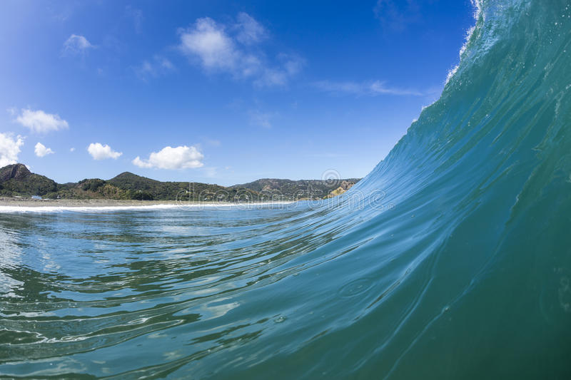 Wave Pitching, North Piha, New Zealand. A water shot taken as a perfect wave starts to pitch at North Piha Beach, New Zealand stock images