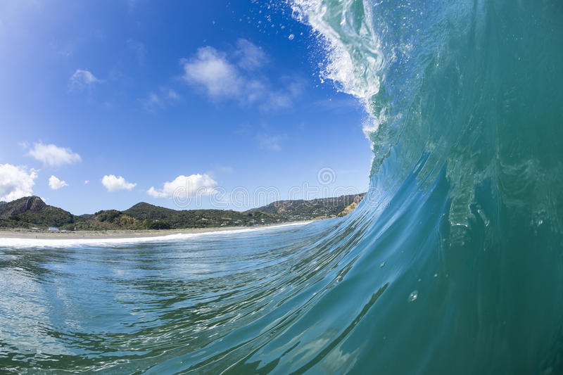 Wave Pitching, North Piha, New Zealand. A water shot taken as a perfect wave starts to pitch at North Piha Beach, New Zealand stock photo