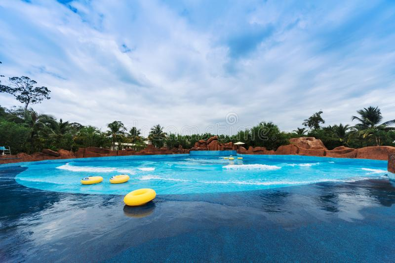 wave pool and swimming laps stock images
