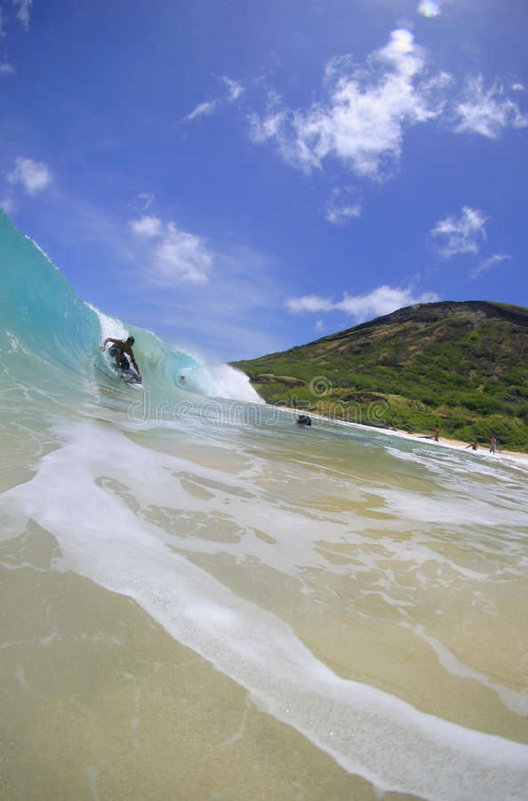 Wave Riding Boogieboarder at Sandy Beach, Hawaii. A Bodyboarder catches a wave at Sandy Beach in Hawaii royalty free stock photo