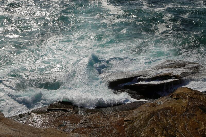 The wave and rock royalty free stock image