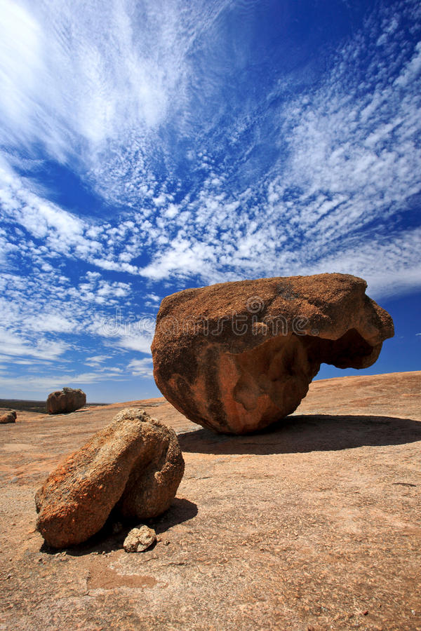 Wave Rock In Western Australia. Giant rocks in abstract sharp stand on top of the wave rock, west australia royalty free stock photography