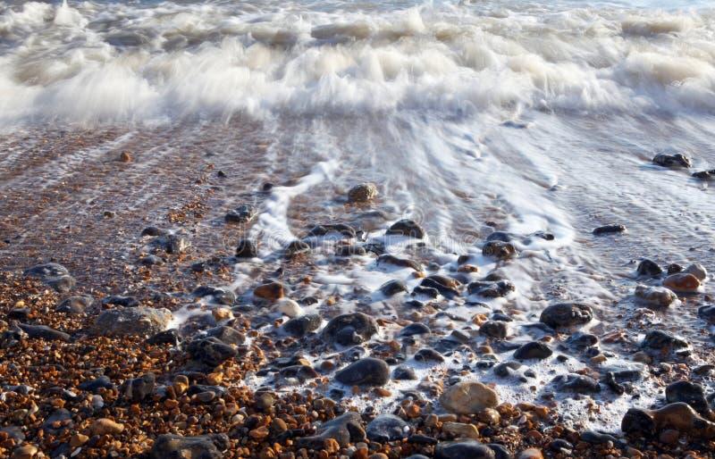 Wave sea pebble beach royalty free stock photos