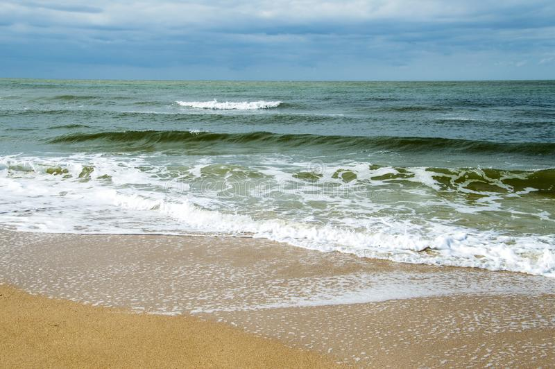 Wave on the sea sendy beach and cloud royalty free stock images