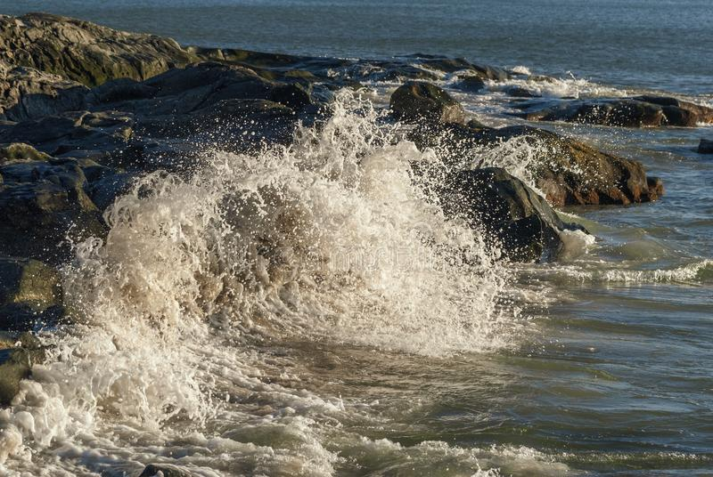 Wave smashes itself to foam stock photo