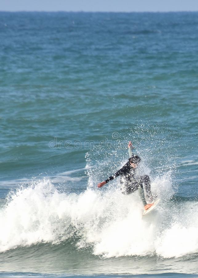 Wave surfer rides within a splash royalty free stock photography
