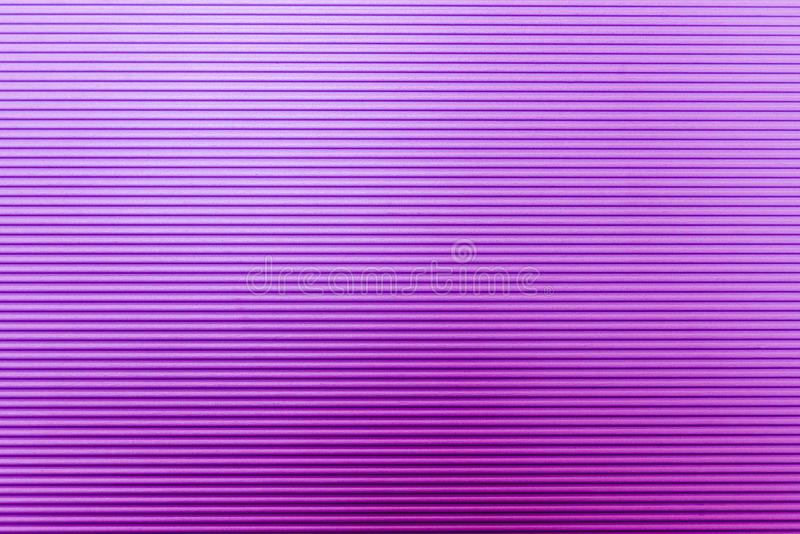 The wave texture of the violet or purple paper stock photo