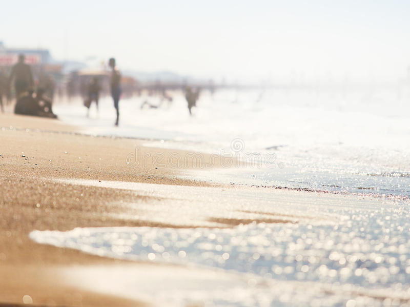 A wave thinning out of the sand of a beach royalty free stock photography