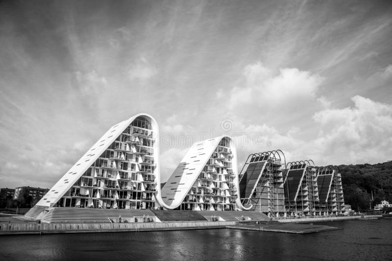 The Wave in Vejle, Denmark. Vejle, Denmark - October 29, 2016: The wave, a modern residential house design by Henning Larsen Architects in black and white royalty free stock image