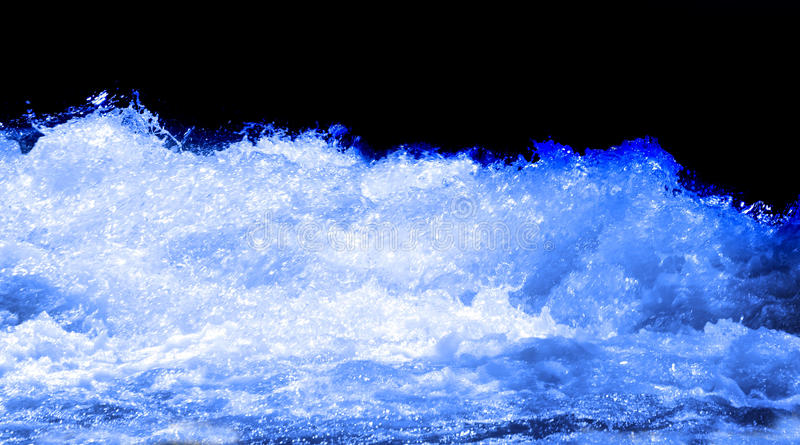 Wave of Water. Isolated on black stock photo