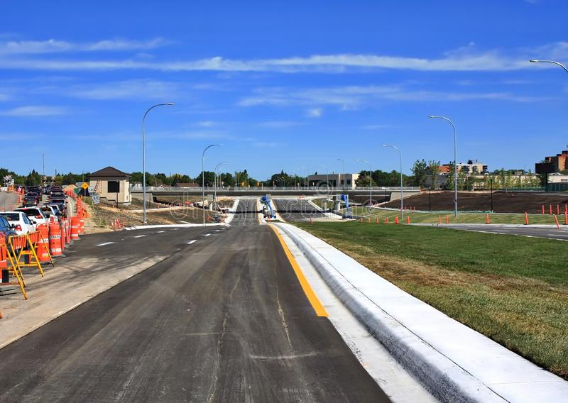 Waverley Street Underpass Construction August 2019. Winnipeg  manitoba  canada. Looking north on waverley street grass in place and lines for traffic set royalty free stock photo