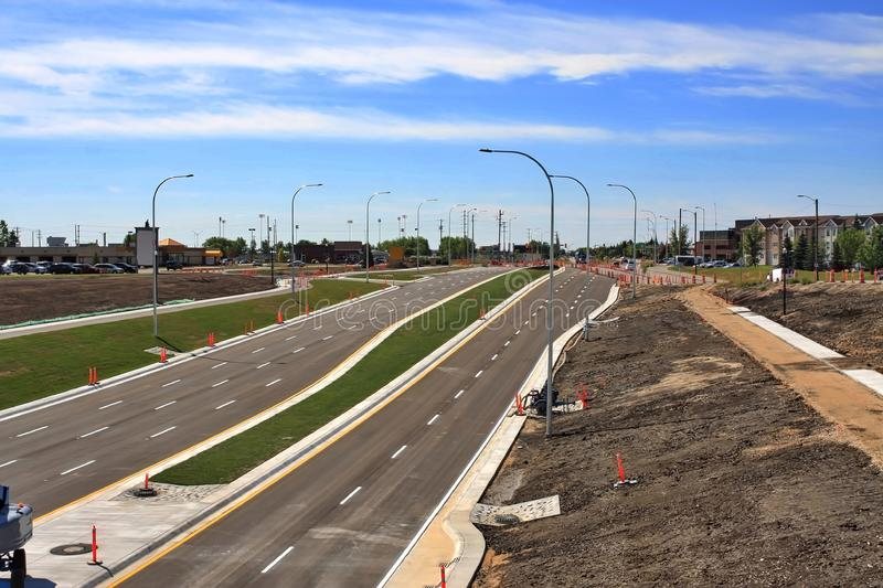 Waverley Street Underpass Construction August 2019. Winnipeg  manitoba  canada. Looking south from rail bridge on waverley street ,grass in place and lines for stock image