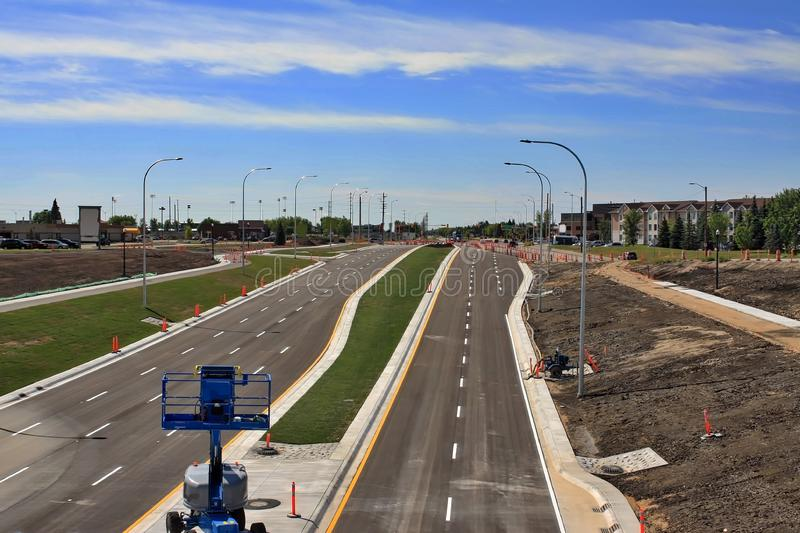 Waverley Street Underpass Construction August 2019. Winnipeg  manitoba  canada. Looking south from rail bridge on waverley street ,grass in place and lines for royalty free stock image