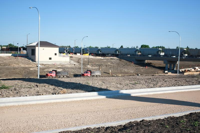 Waverley Street Underpass Construction June 2019. Winnipeg manitoba  canada. Looking east at the rail bridge and completed pumping station house royalty free stock image