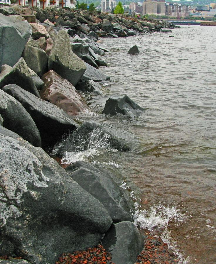 Splashing Waves Against Duluth`s rocky breakwater royalty free stock image