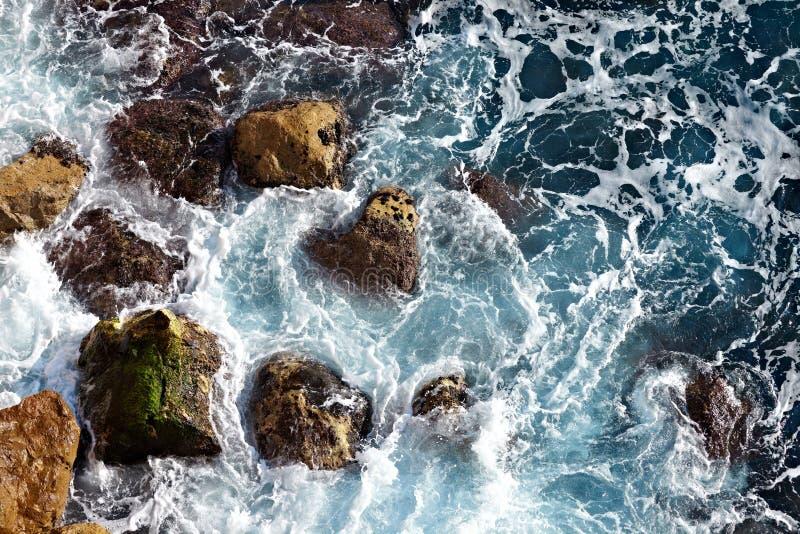 Waves ashore. Waves hitting the sea shore stock photos