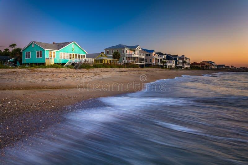 Waves in the Atlantic Ocean and beachfront homes at sunrise, Edisto Beach, South Carolina. Waves in the Atlantic Ocean and beachfront homes at sunrise, Edisto stock photos