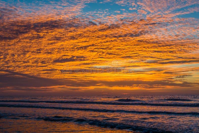 Waves in the Atlantic Ocean and sunrise, at Folly Beach, South Carolina.  royalty free stock photography