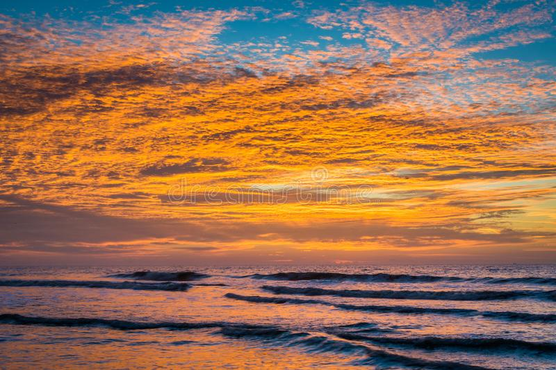 Waves in the Atlantic Ocean and sunrise, at Folly Beach, South Carolina.  stock images