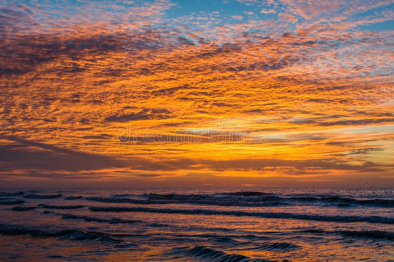 Waves in the Atlantic Ocean at sunrise, in Folly Beach, South Carolina.  royalty free stock photography