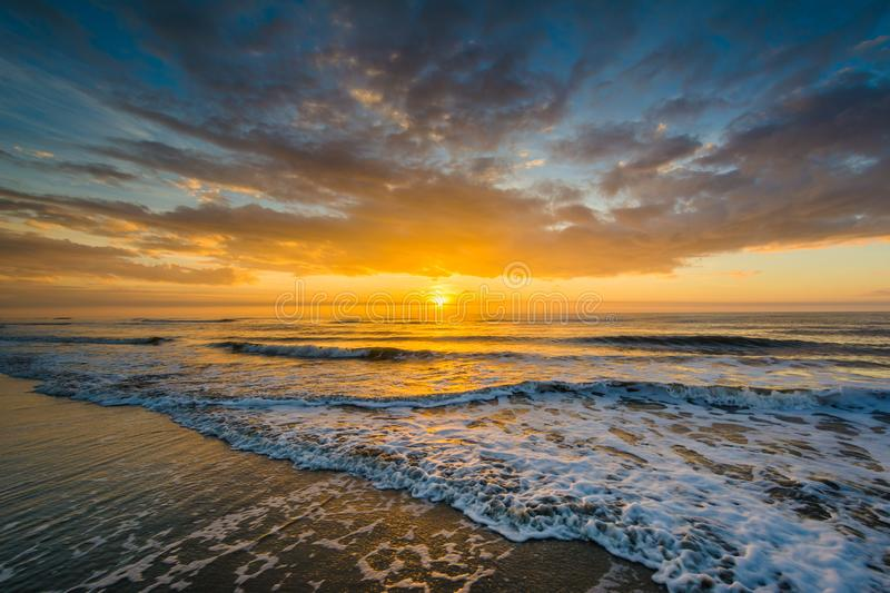 Waves in the Atlantic Ocean and sunrise, in Isle of Palms, South Carolina.  stock photos