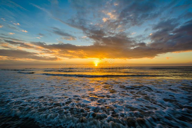 Waves in the Atlantic Ocean and sunrise, in Isle of Palms, South Carolina.  stock image