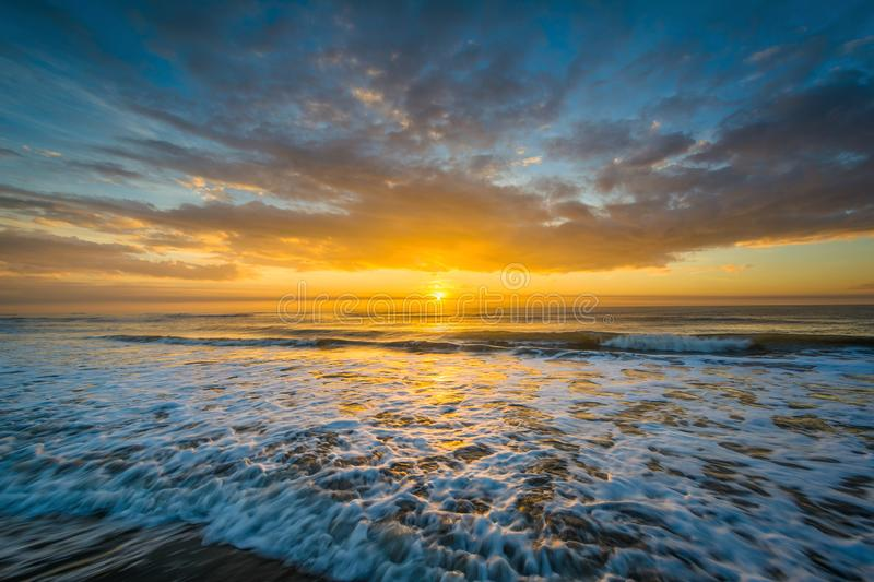 Waves in the Atlantic Ocean and sunrise, in Isle of Palms, South Carolina.  royalty free stock photography