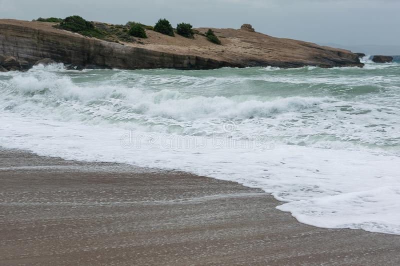 Waves in a bay of the Aegean Sea in Rhodes royalty free stock image