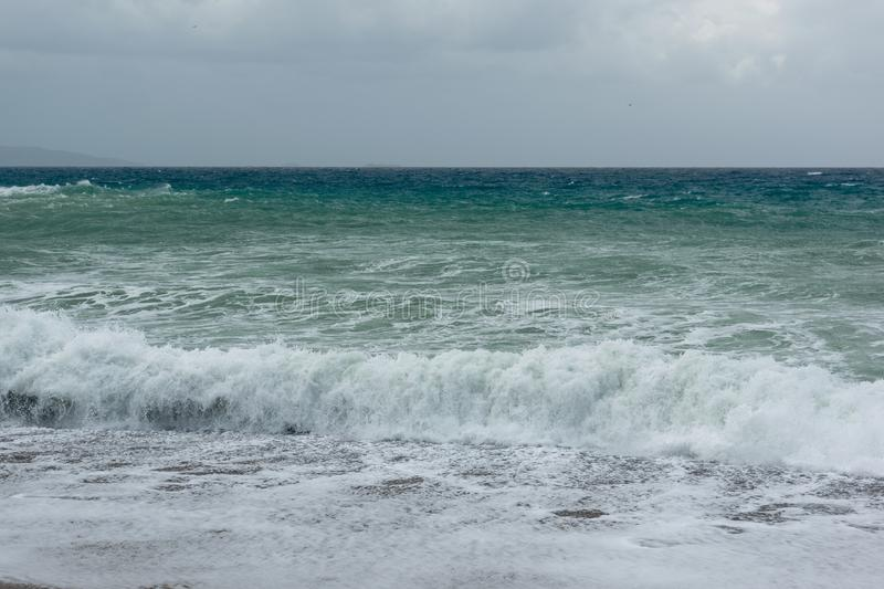 Waves in a bay of the Aegean Sea in Rhodes royalty free stock photos